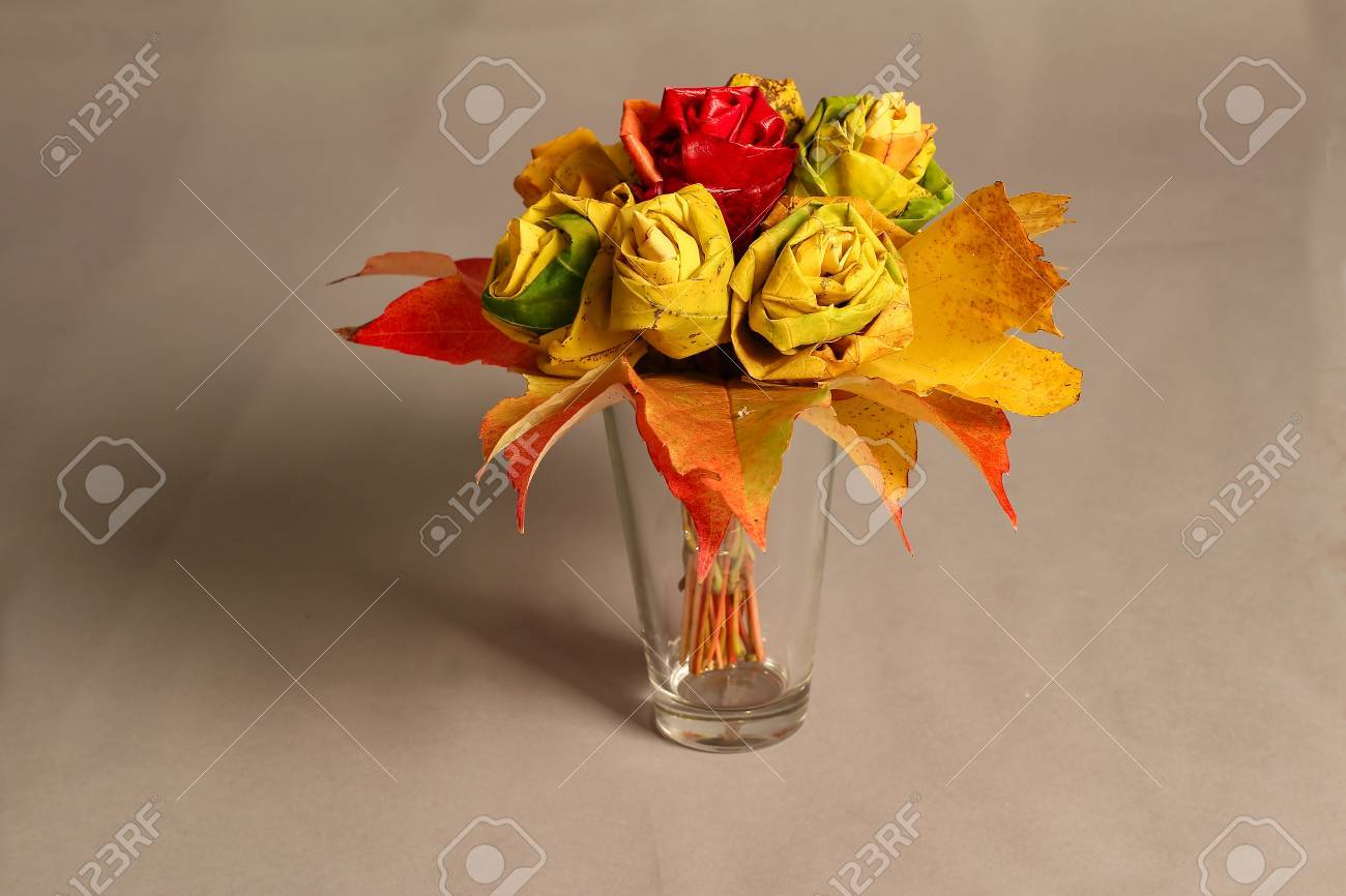 Autumn still life  Decorative roses from maple leaves Standard-Bild - 87871972