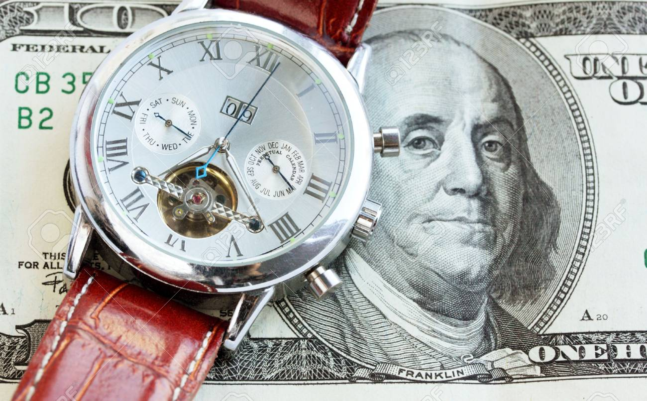 Wrist watch lie on the money / time is money Stock Photo - 7222440