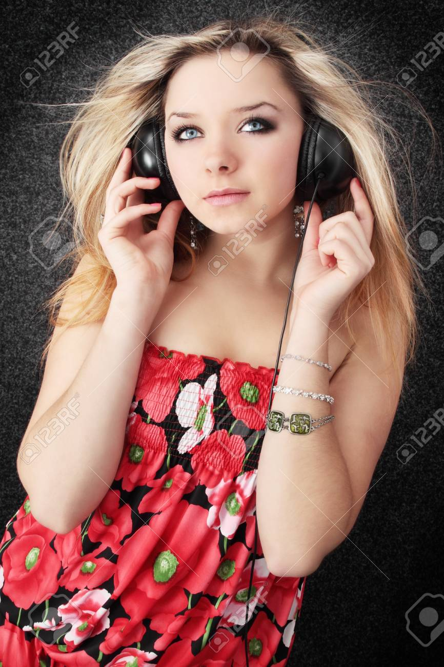 Young beautiful blond listens to the music Stock Photo - 8403272