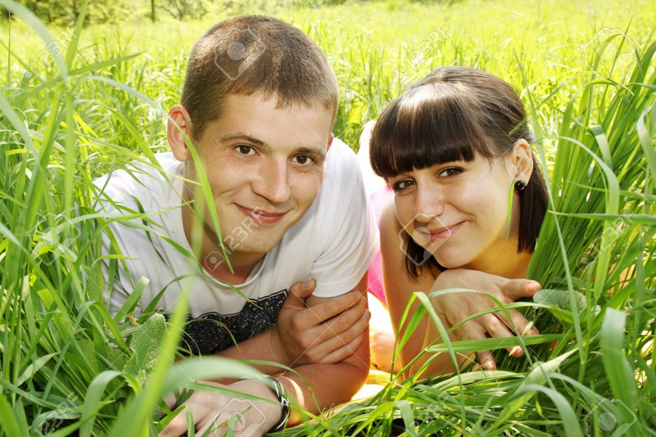 a beautiful young couple lying on grass Stock Photo - 13917108