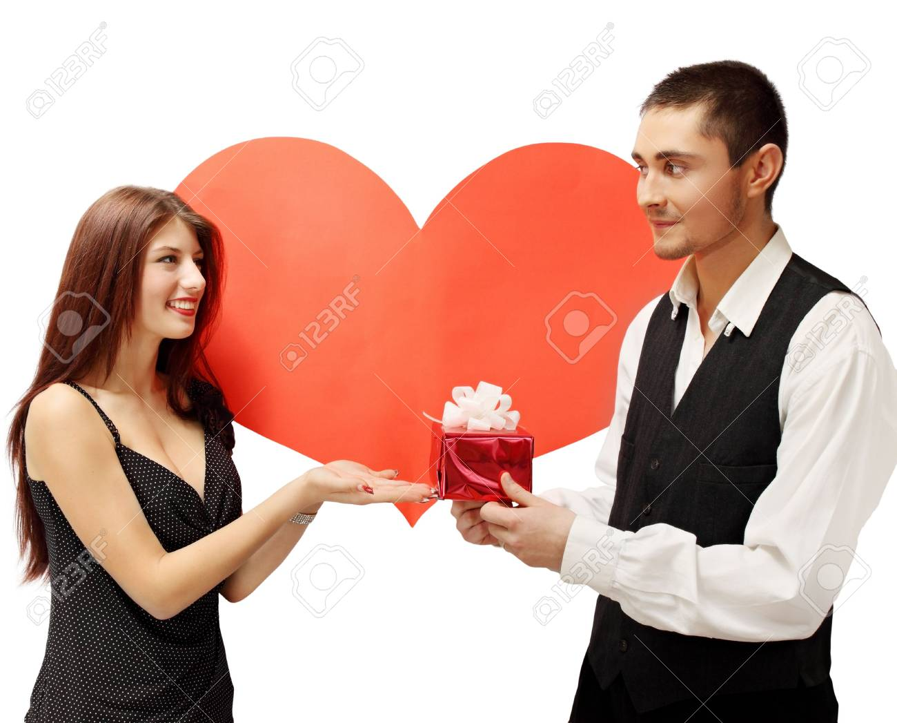 The young man gives a woman a gift Stock Photo - 17564955