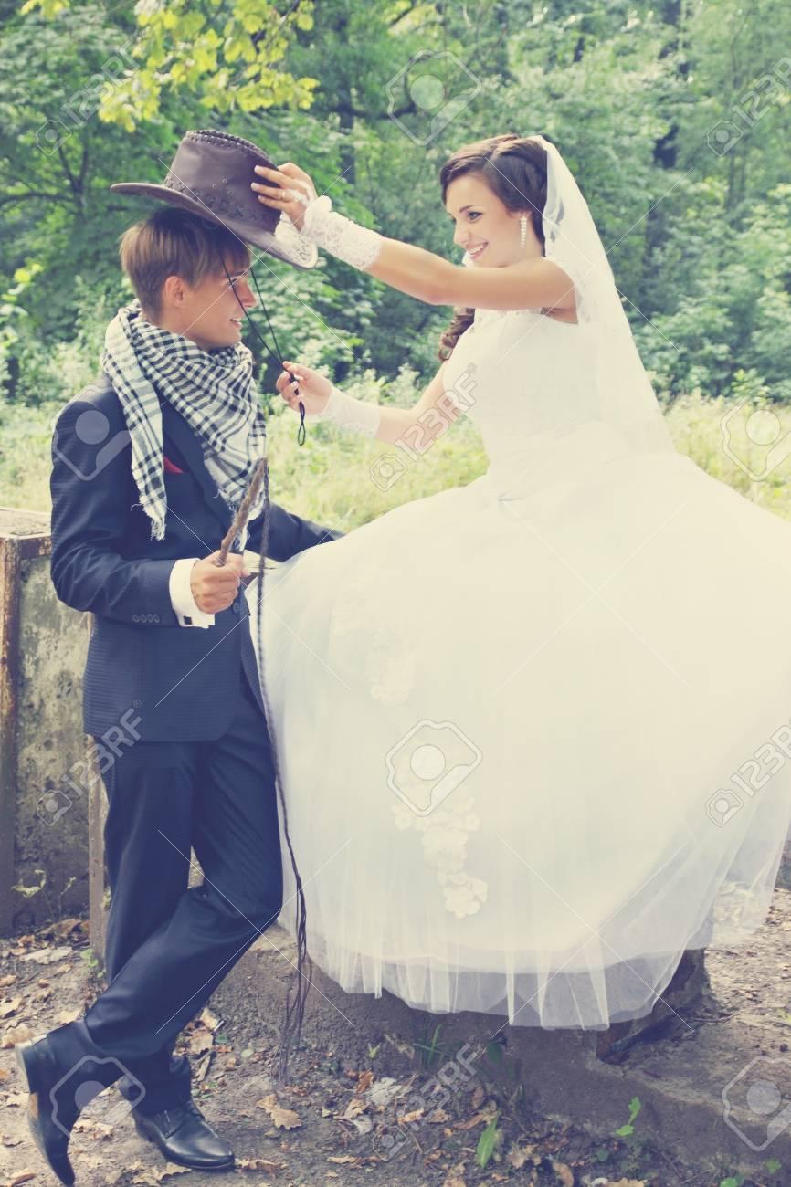 e4317d37cf6 Stock Photo - the bride wears a cowboy hat groom