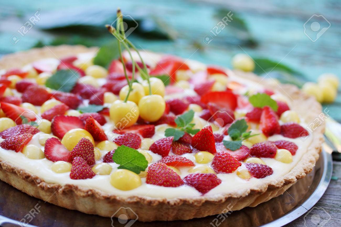 Cake With A Shortcrust Pastry Custard Fruit Cherries And Strawberries Stock Photo