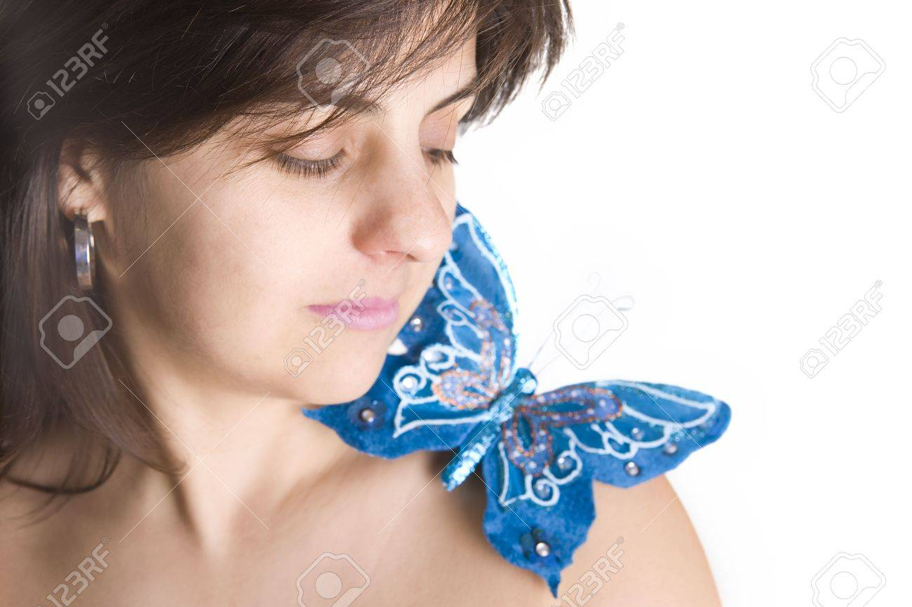 beautiful young woman with blue butterfly in her naked shoulder - focus on the eye Stock Photo - 2992775