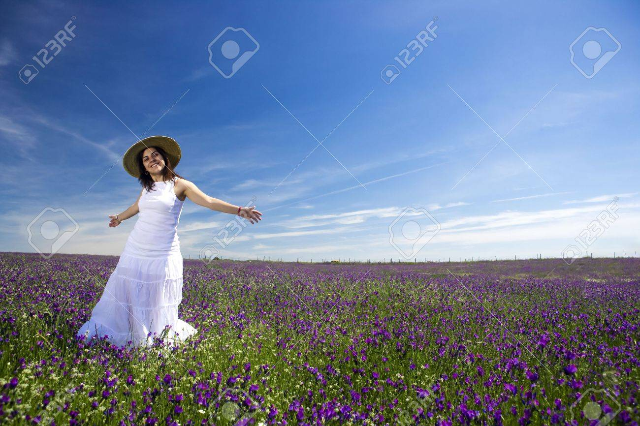 beautiful young woman in white dress enjoying nature Stock Photo - 3123847