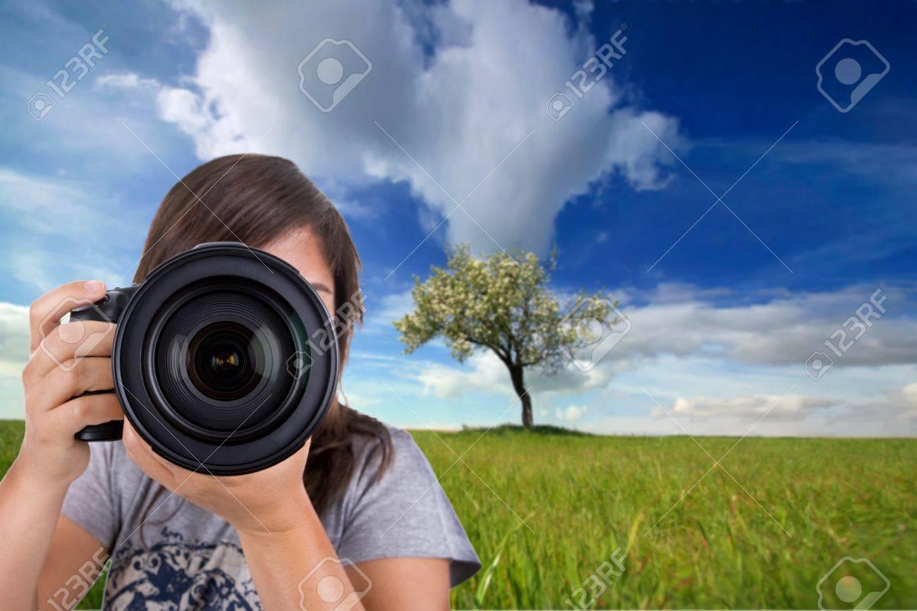 young female photographer with digital photo camera shotting landscape scene Stock Photo - 4130942