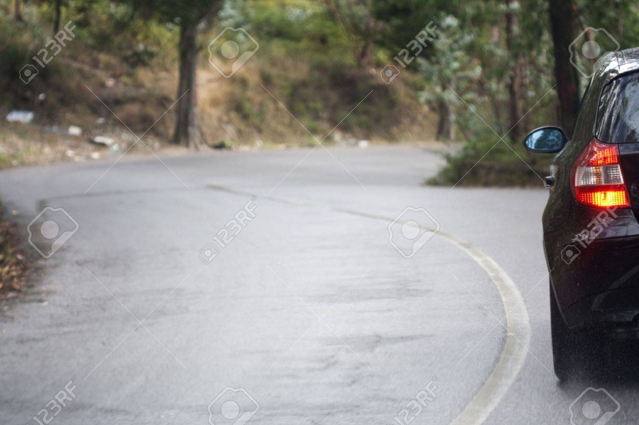 Car in wet curvy road - landscape orientation Stock Photo - 4864016
