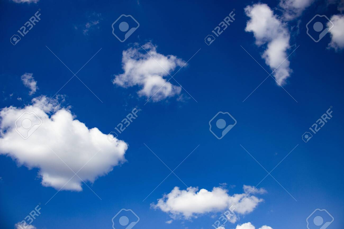 Blue sky and white fluffy clouds. Beautiful background for design or greeting card. - 143621762