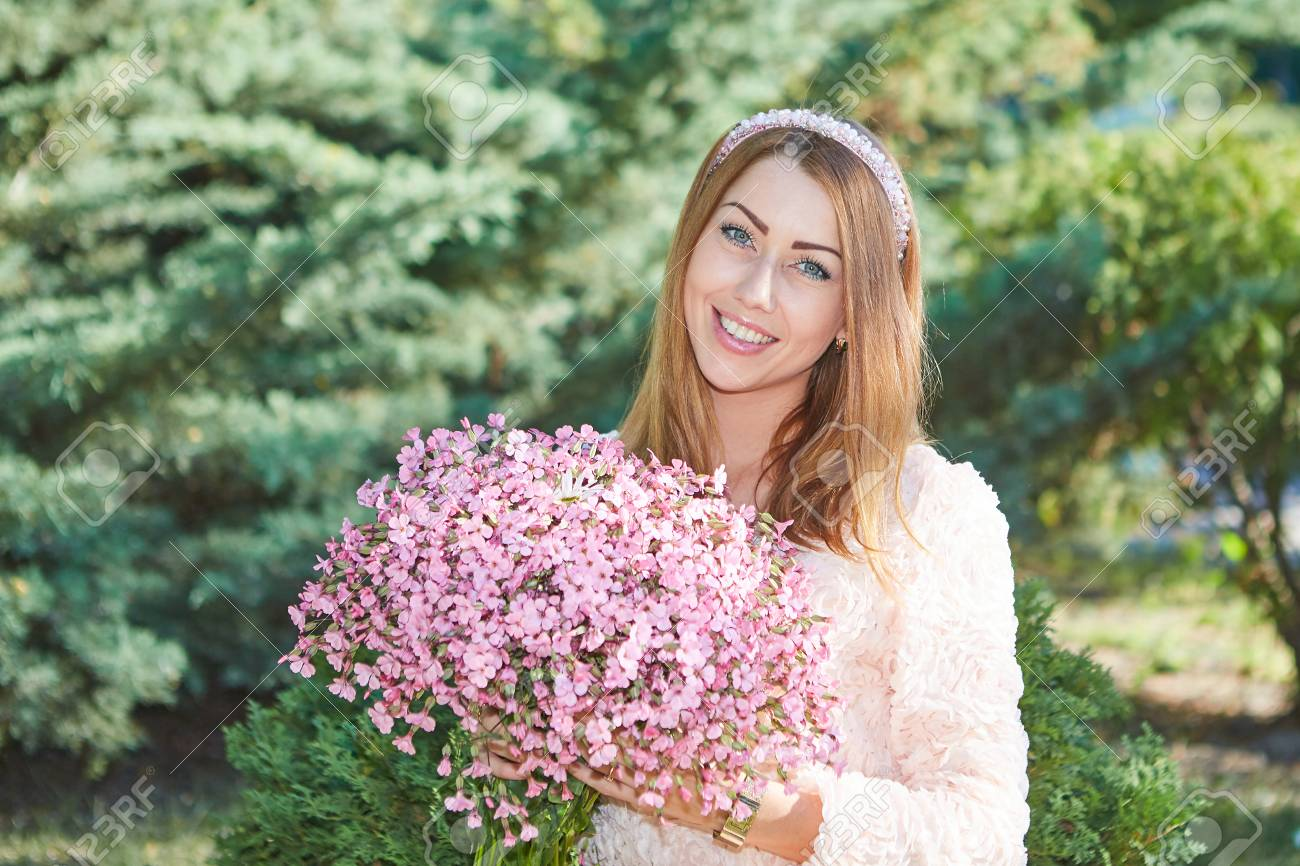 Beautiful girl with bouquet of flowers in the garden pleasure beautiful girl with bouquet of flowers in the garden pleasure sunlight and warmth izmirmasajfo