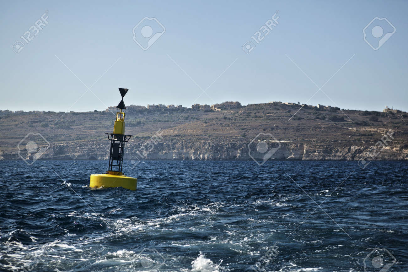 A reef hazard marker buoy off the coast of Comino in Malta. Stock Photo - 10335698
