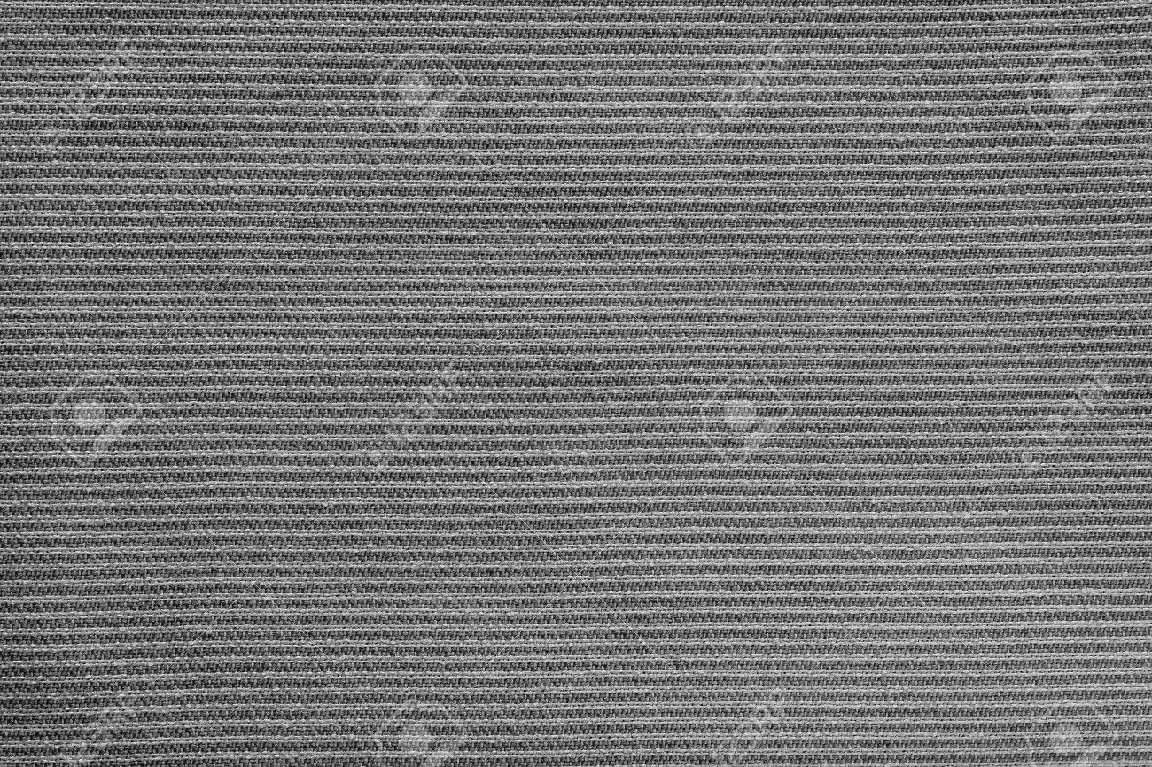抽象的な背景と黒の色の壁紙のストライプ生地の質感を不織布 の写真