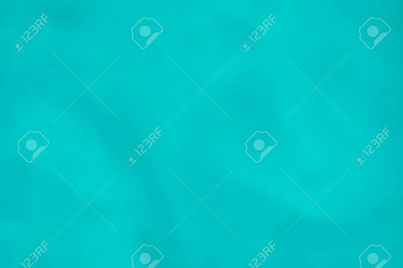 Continuous Smooth Texture And Background Of Paper Or Fabric Bright Turquoise Color Stock Photo
