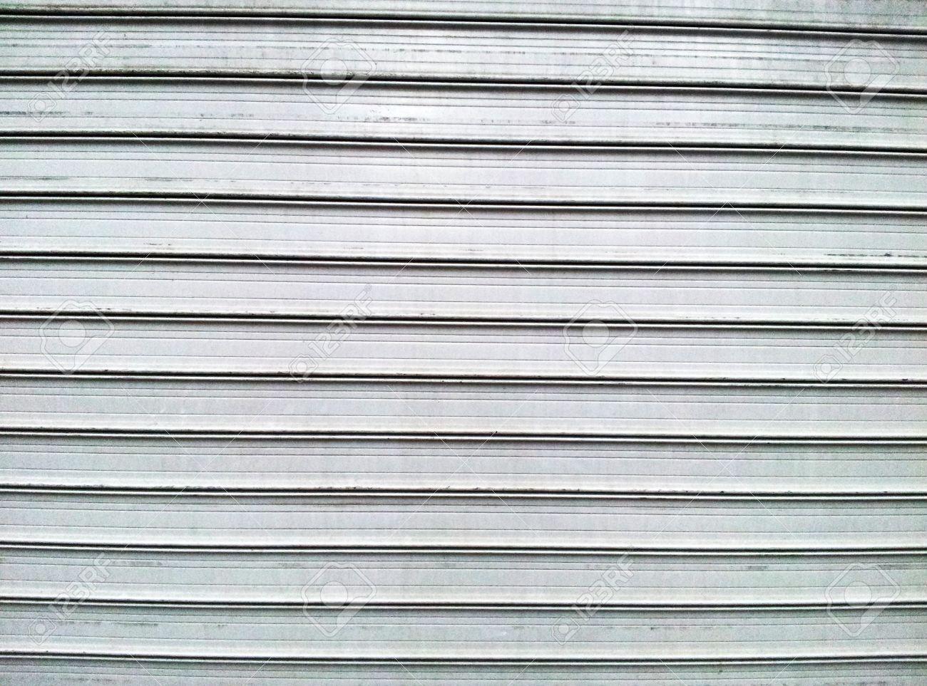 Gray steel garage door with horizontal lines stock photo picture gray steel garage door with horizontal lines stock photo 19082530 rubansaba