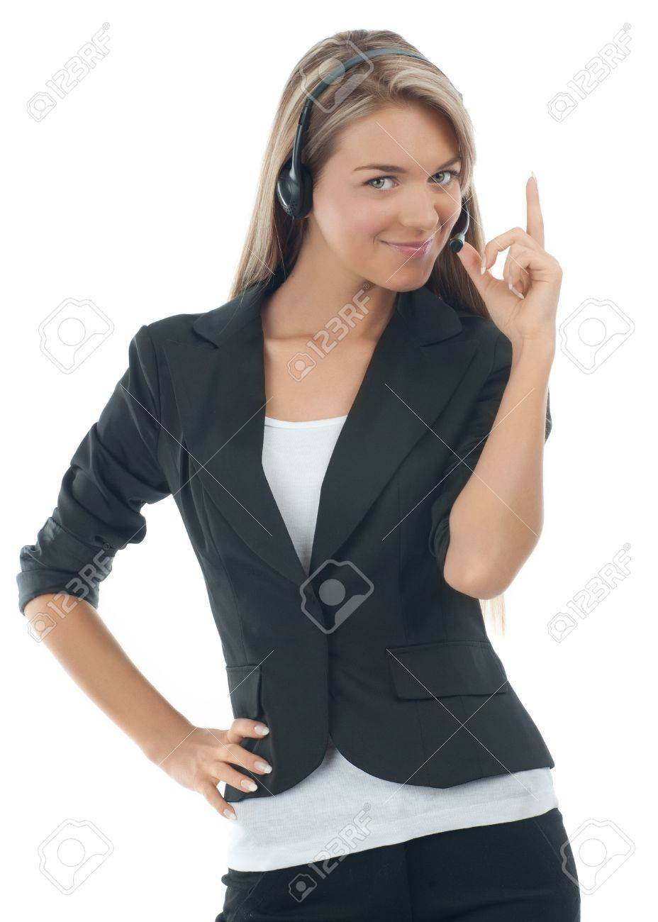 Portrait of a pretty young female call center employee wearing a headset with finger pointing up, against white background Stock Photo - 10827830