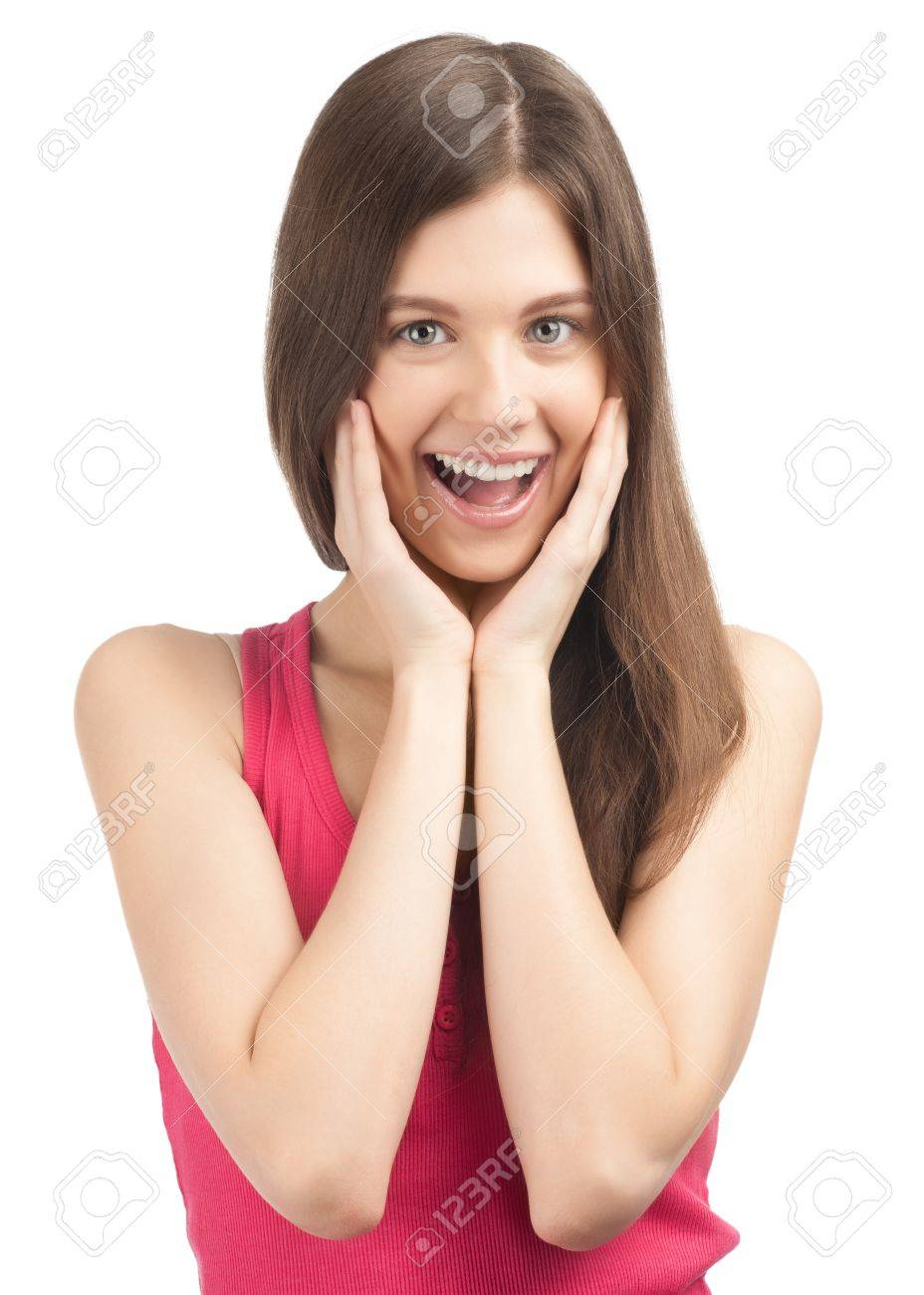 Portrait of surprised beautiful girl  in casual wear holding her face in astonishment. Isolated on white background. Stock Photo - 10828344