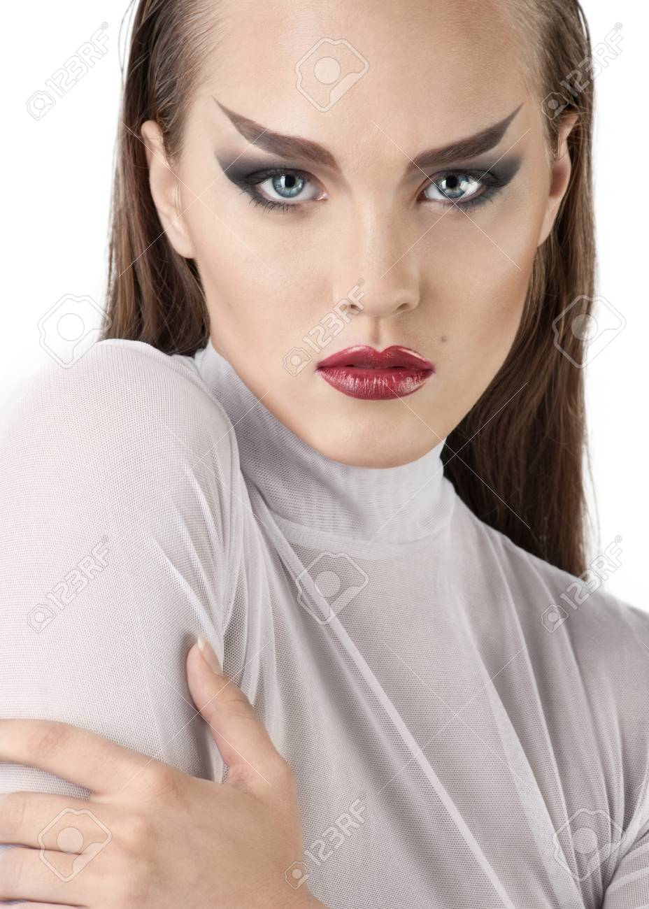 Fashion studio shot of young and beautiful woman looking at camera. Wearing white blouse. (Professional makeup and hair style). Stock Photo - 10841277