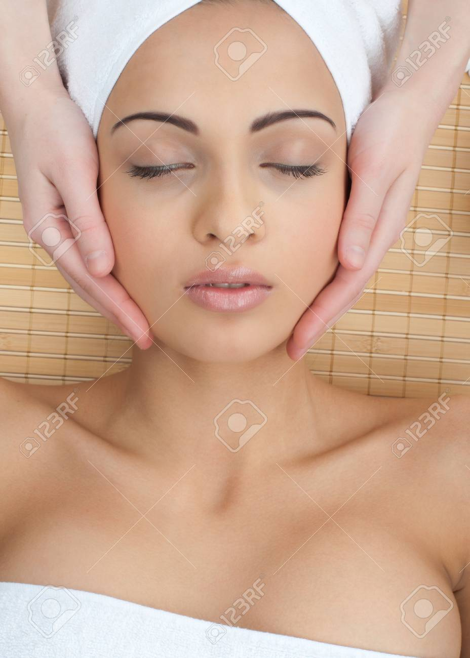 Close-up of a female receiving facial massage at spa salon Stock Photo - 10844848