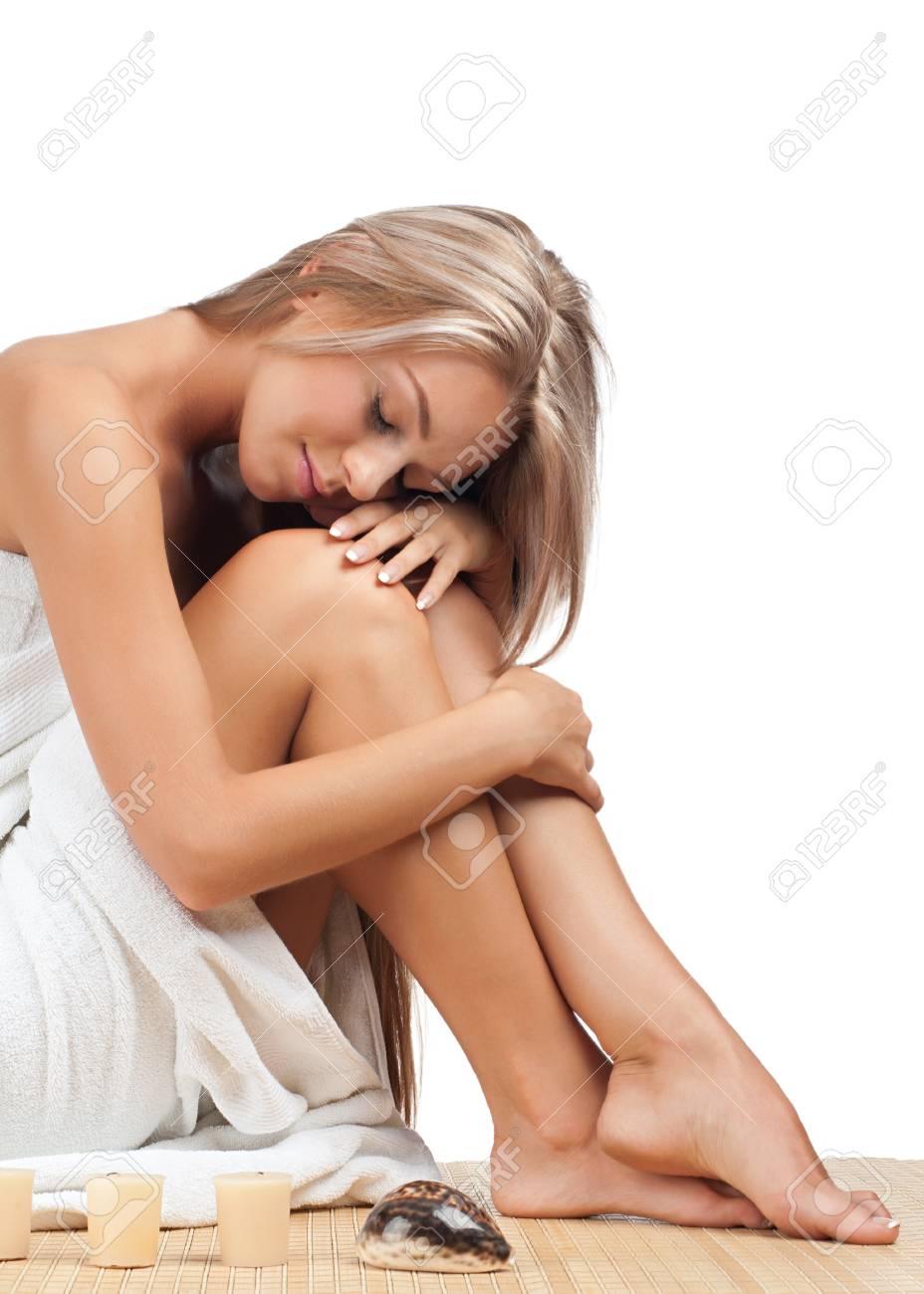 Portrait of young beautiful spa woman sitting on bamboo mat at spa salon Stock Photo - 10844772