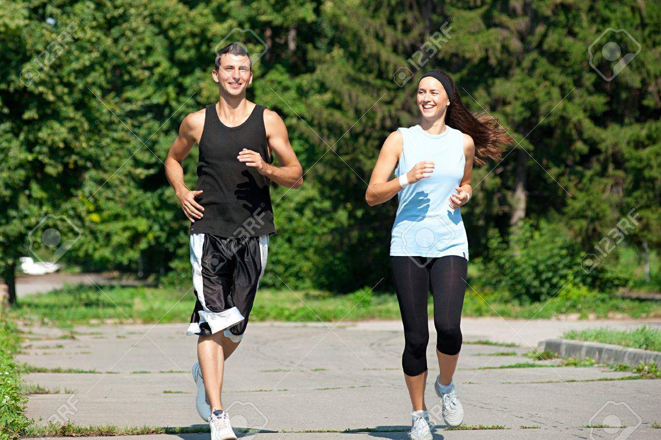 Young fitness couple of man and woman jogging in park Stock Photo - 10947916