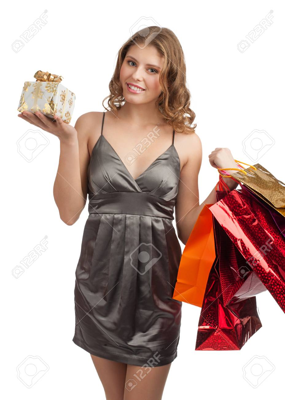 Woman shopping for christmas gifts. Happy young caucasian woman with gifts and shopping bags. Stock Photo - 11374989