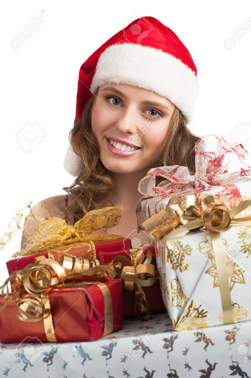 Woman shopping for christmas. Happy young woman in santa hat with gifts. Stock Photo - 11375055