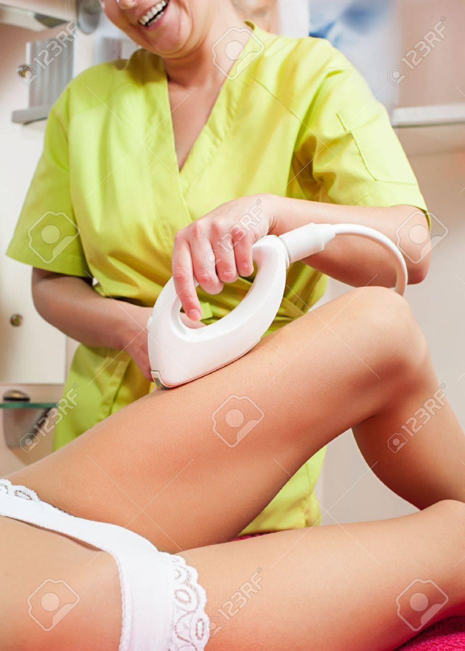 Young woman getting radio frequency cellulite treatment in spa salon Stock Photo - 11374986
