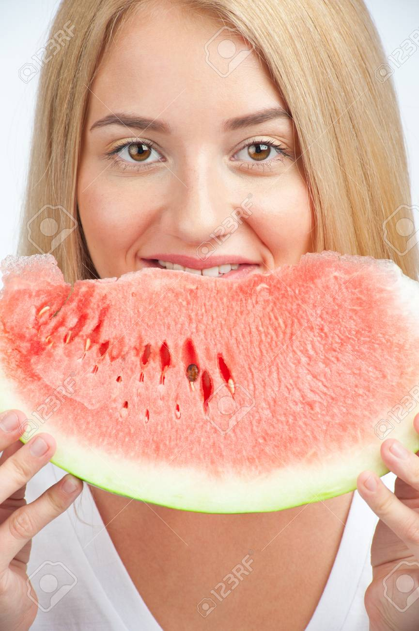 Close-up of young beautiful woman with long blond hair eating fresh watermelon Stock Photo - 11380025