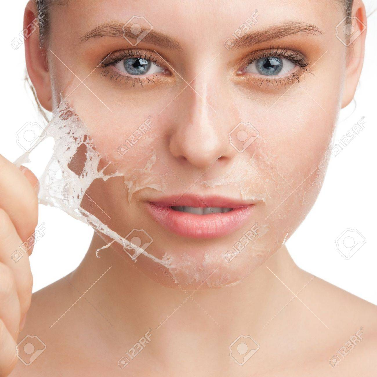 Close-up of beautiful young woman removing old damaged skin from her face Stock Photo - 11741848
