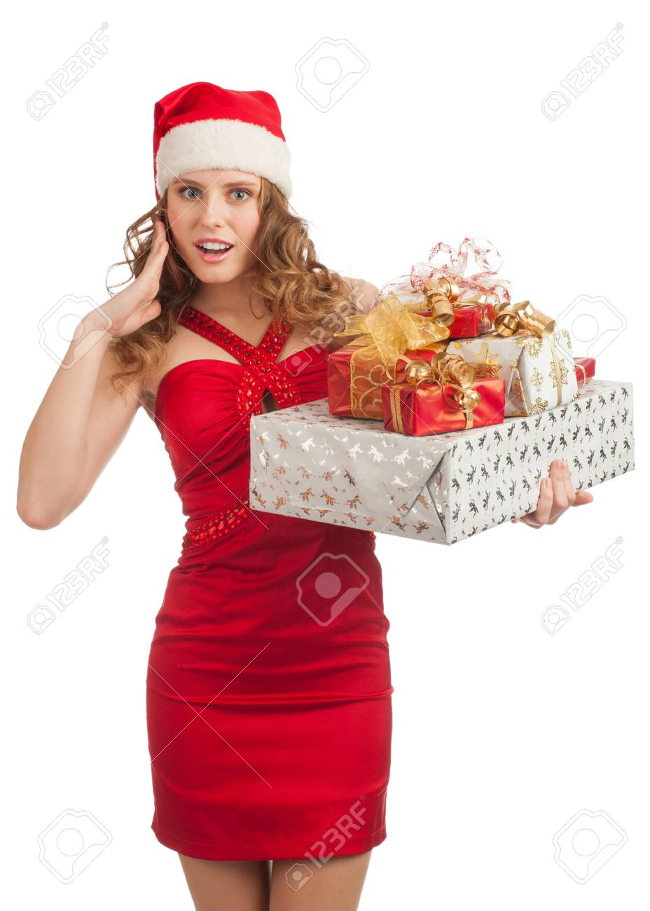 595be14bd2605 Excited Christmas shopping woman santa hat holding many Christmas gifts in her  hands Stock Photo -