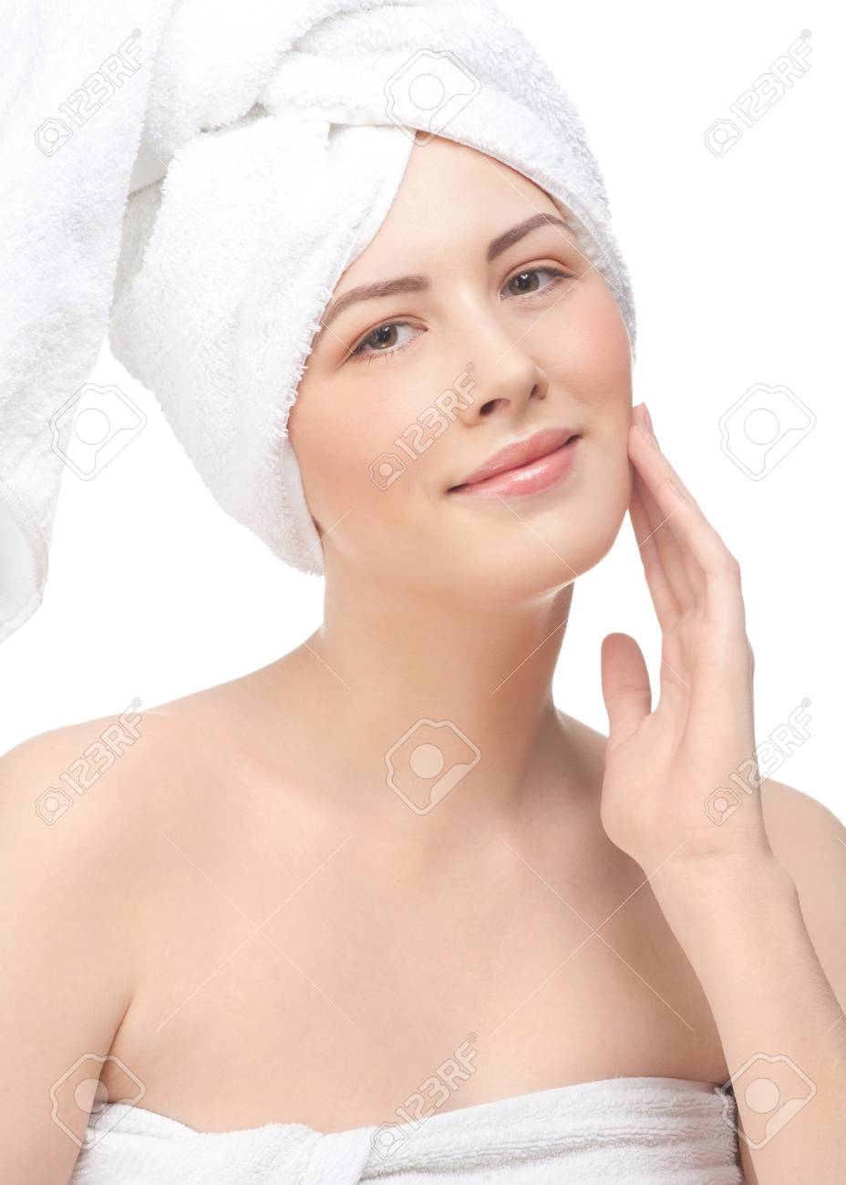 Portrait of young beautiful woman applying moisturizing cream on her face, isolated on white background Stock Photo - 12794903
