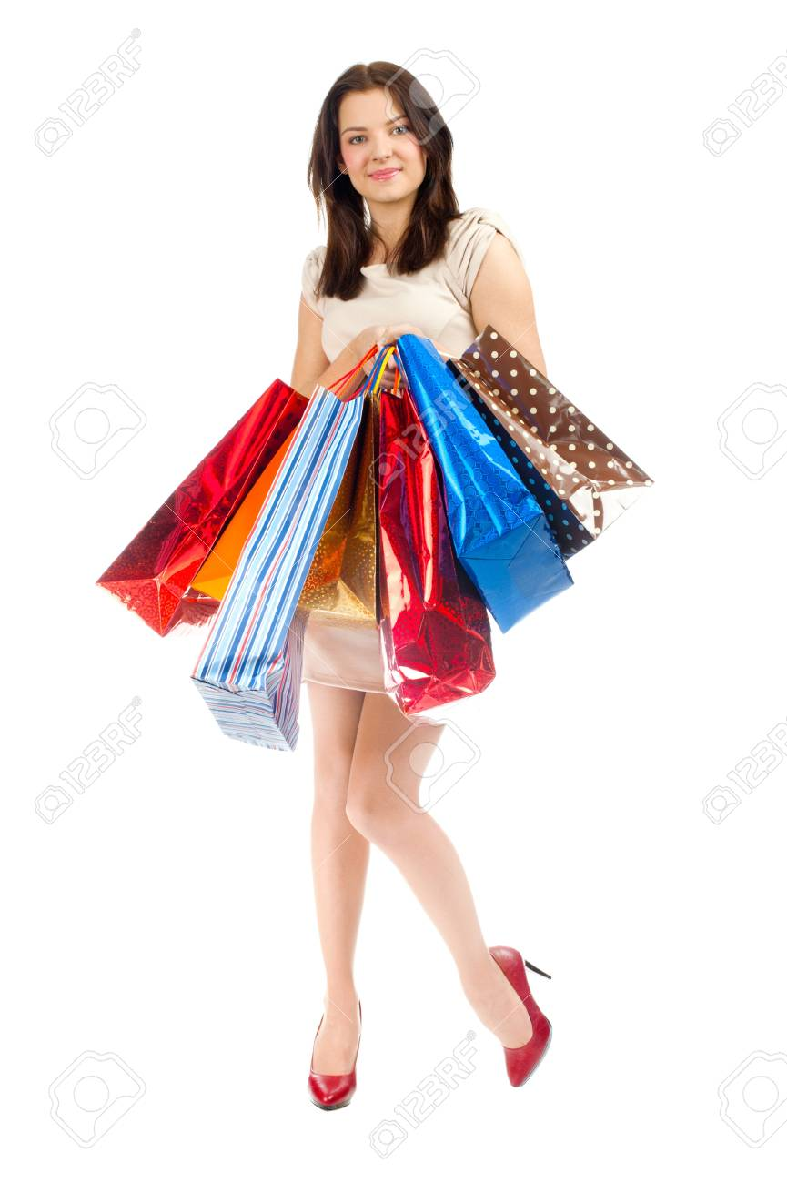 Full length portrait of pretty young woman with colorful shopping bags. Isolated on white background Stock Photo - 13301790