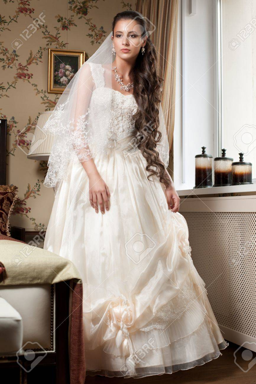 Beautiful Bride In Elegant Wedding Dress With Long Curly Hair ...