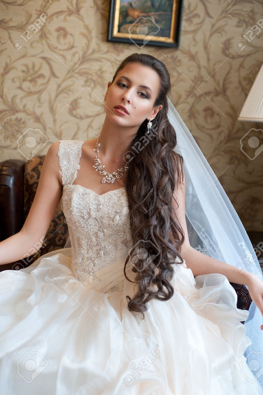 Beautiful Bride In Elegant Wedding Dress With Long Curly Hair Stock