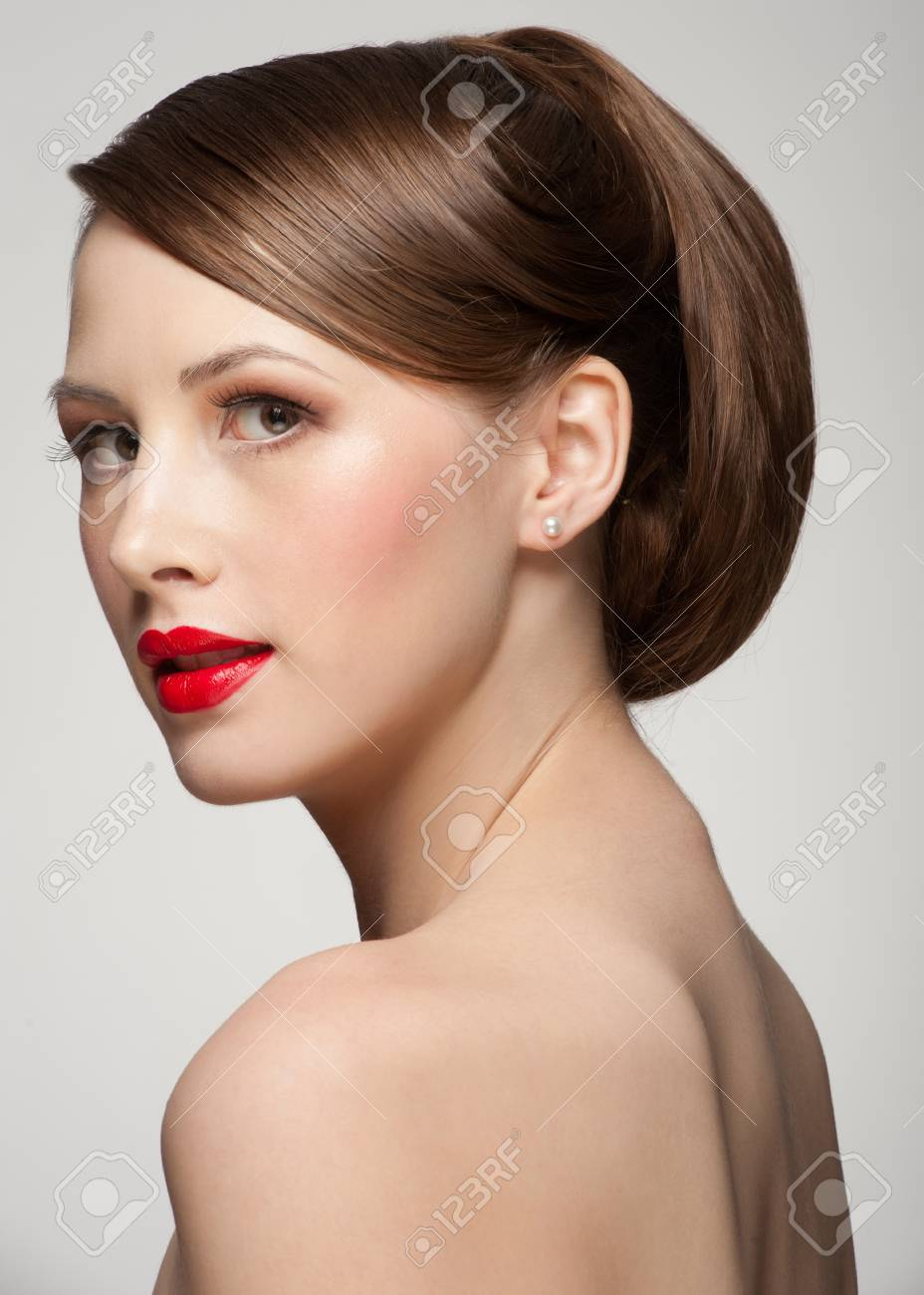 Portrait of attractive young woman with beautiful make-up and hairstyle Stock Photo - 15442451