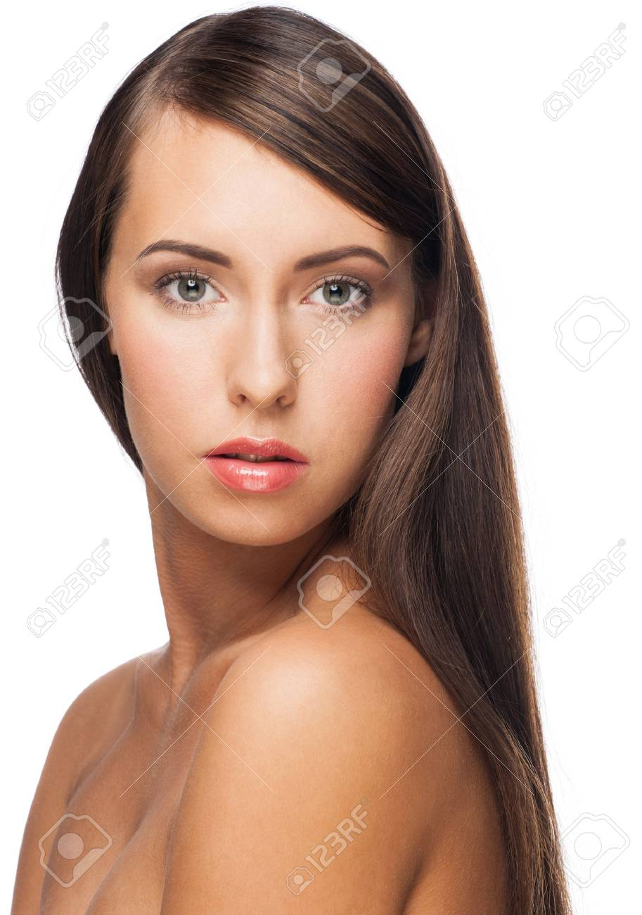 Pretty young woman with long straight brown hair looking at camera, isolated on white background Stock Photo - 16802899