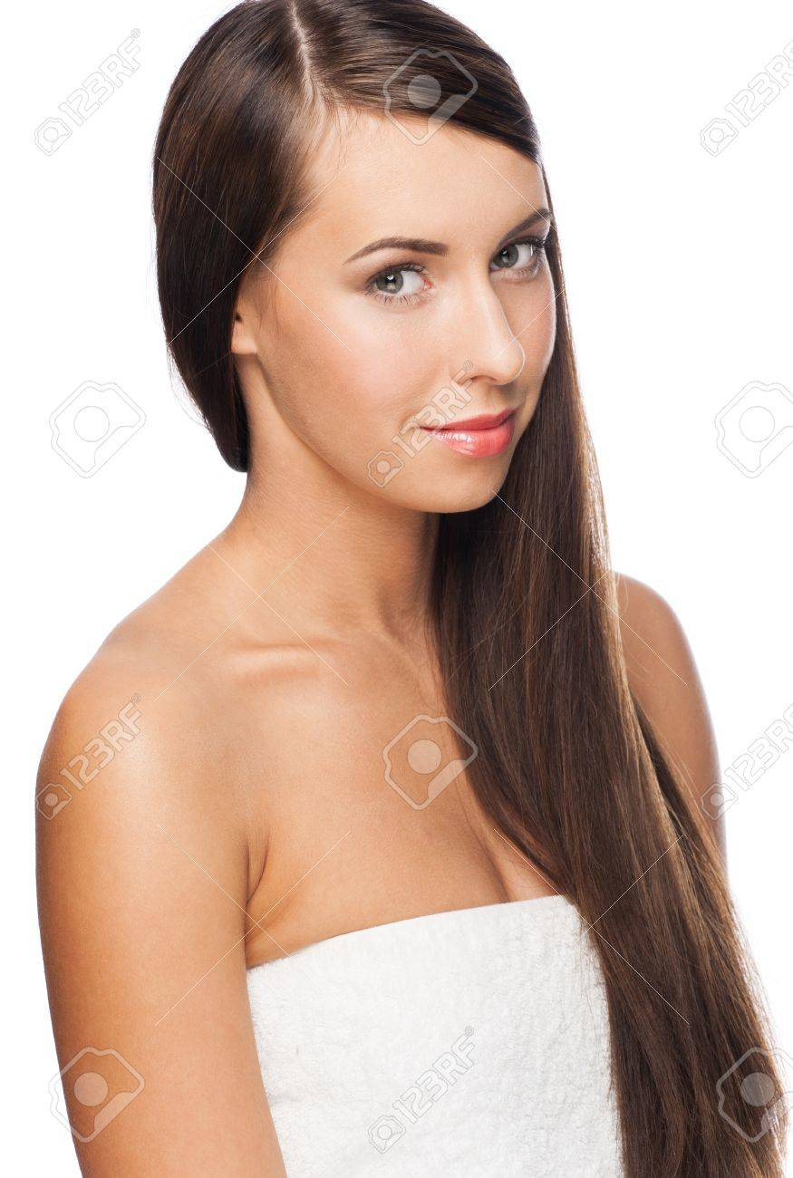 Pretty young woman with long straight brown hair looking at camera, isolated on white background Stock Photo - 16802925