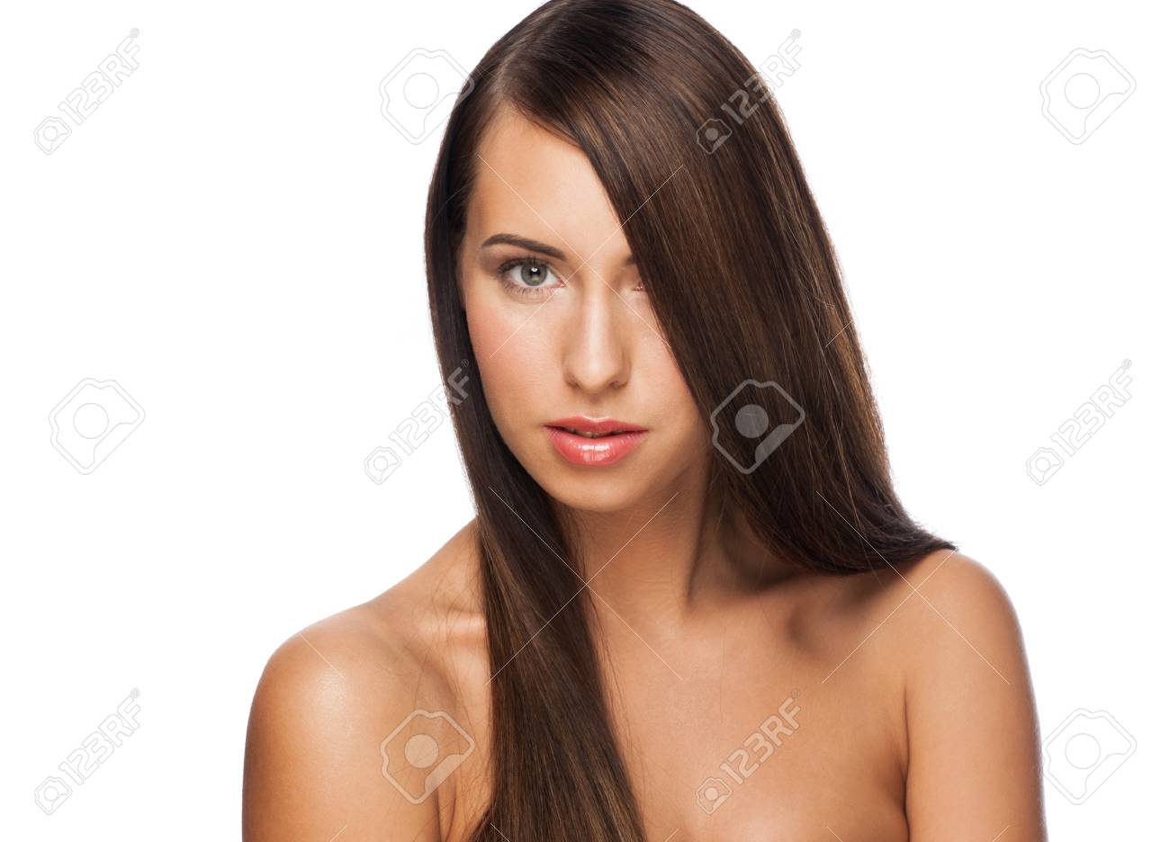 Pretty young woman with long straight brown hair looking at camera, isolated on white background Stock Photo - 16802768