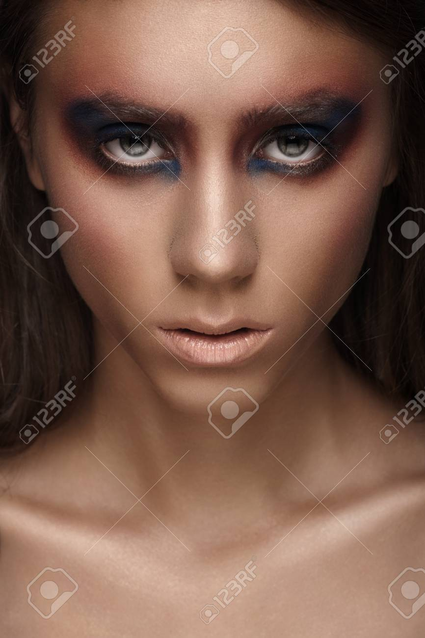 Closeup portrait of attractive young woman with bright creative makeup Stock Photo - 17255268