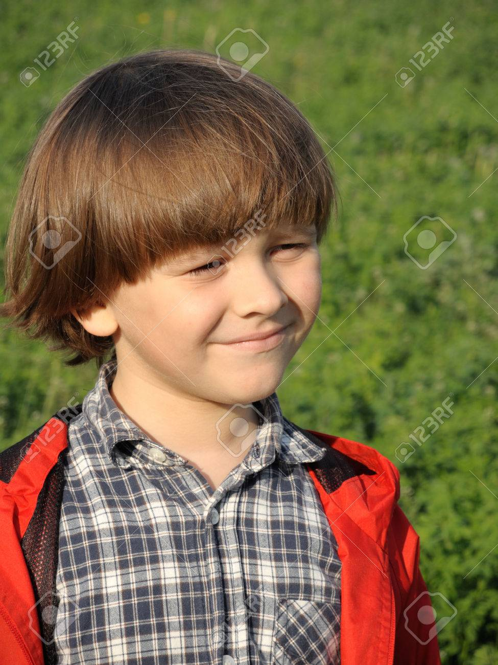 Portrait of a smiling young boy on the nature. Happiness, fashionable concept. Lifestyle. - 43075953