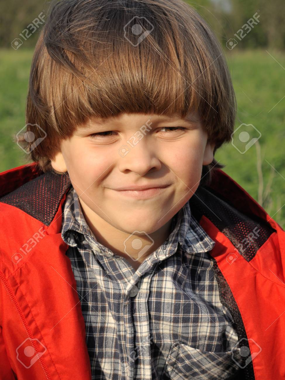 Portrait of a smiling young boy on the nature. Happiness, fashionable concept. Lifestyle. - 43075954