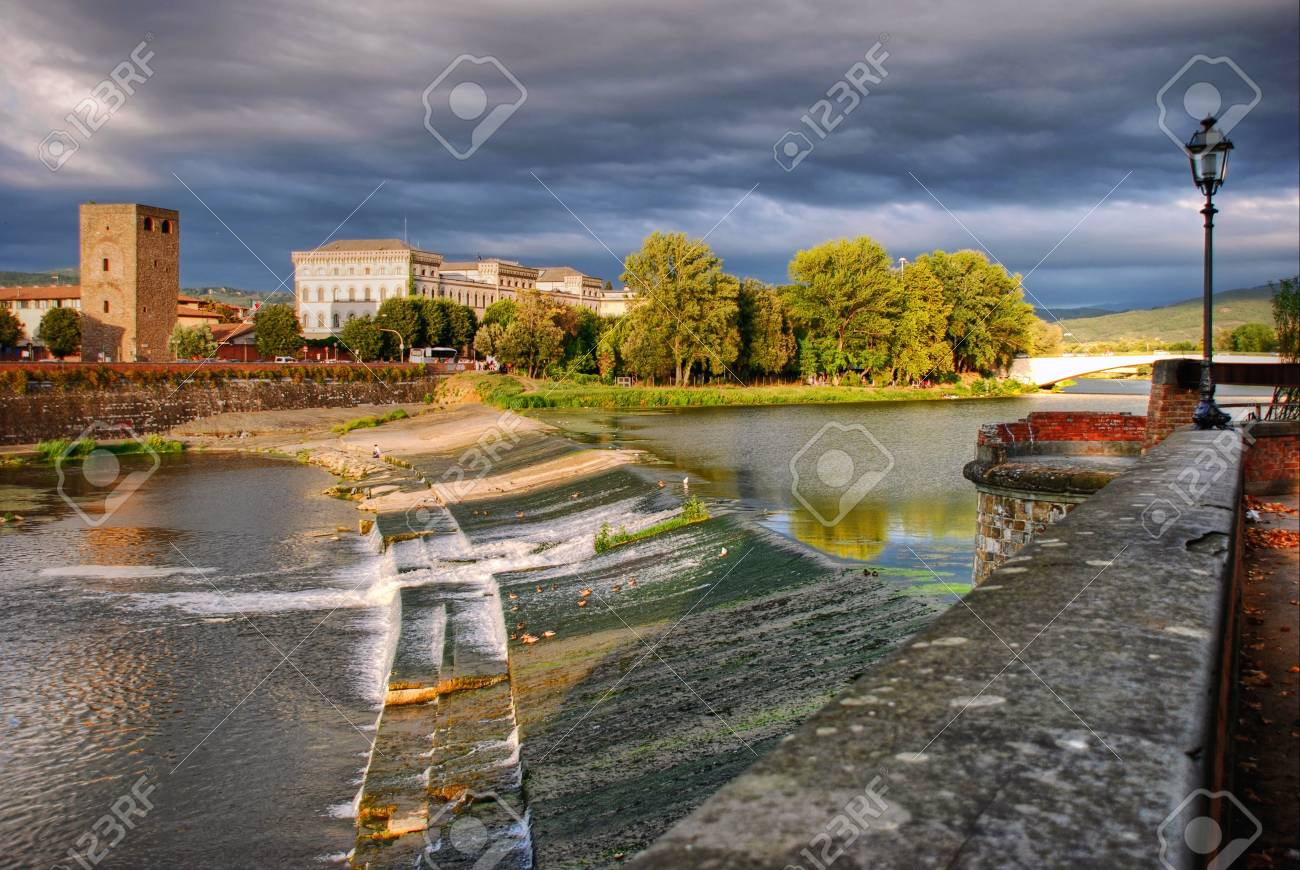 Beautiful view of Florence with reflections in the Arno River and  with majestic powerful clouds Stock Photo - 13323004