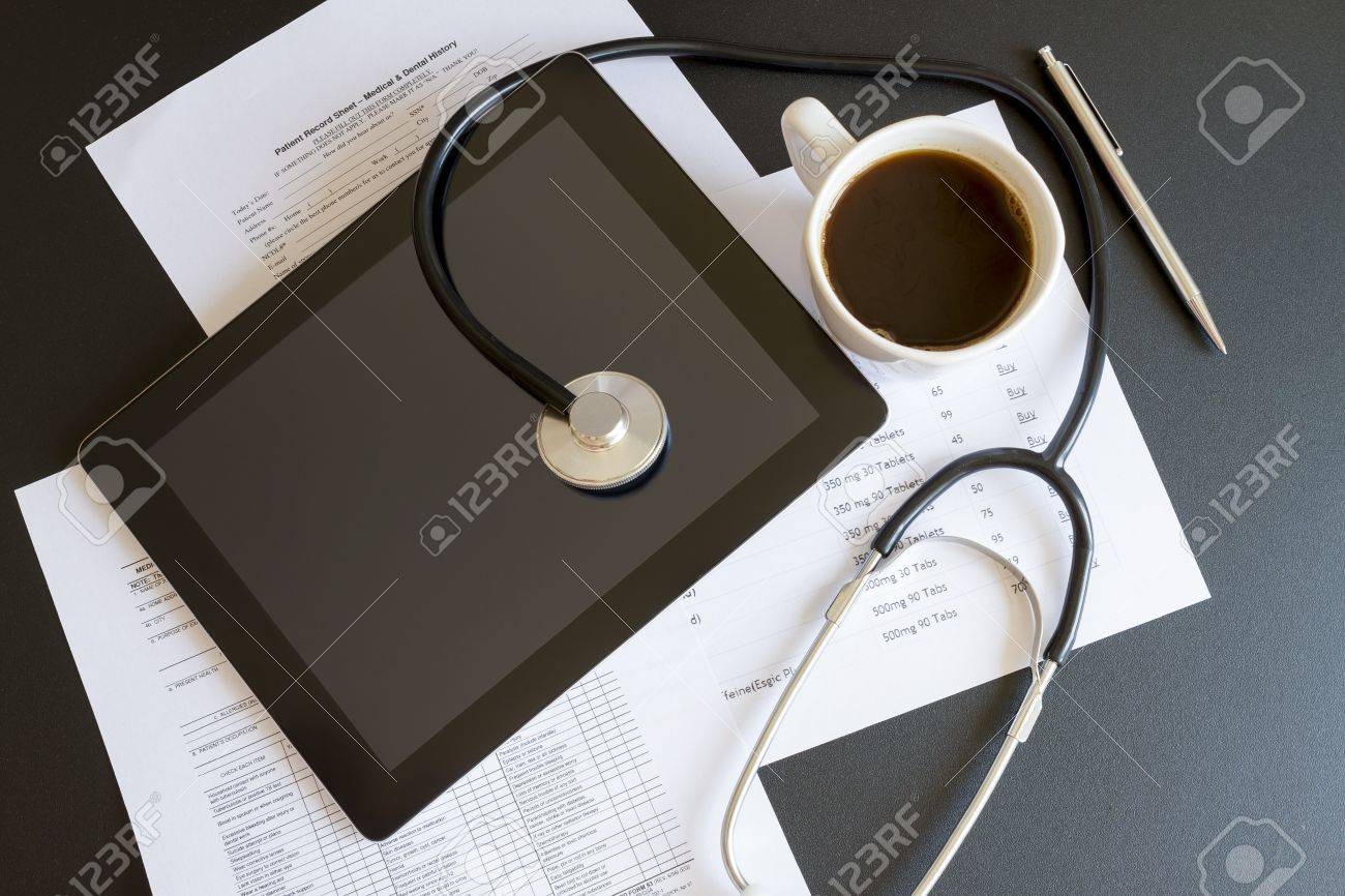 Digital tablet with stethoscope and paperwork Stock Photo - 16003526