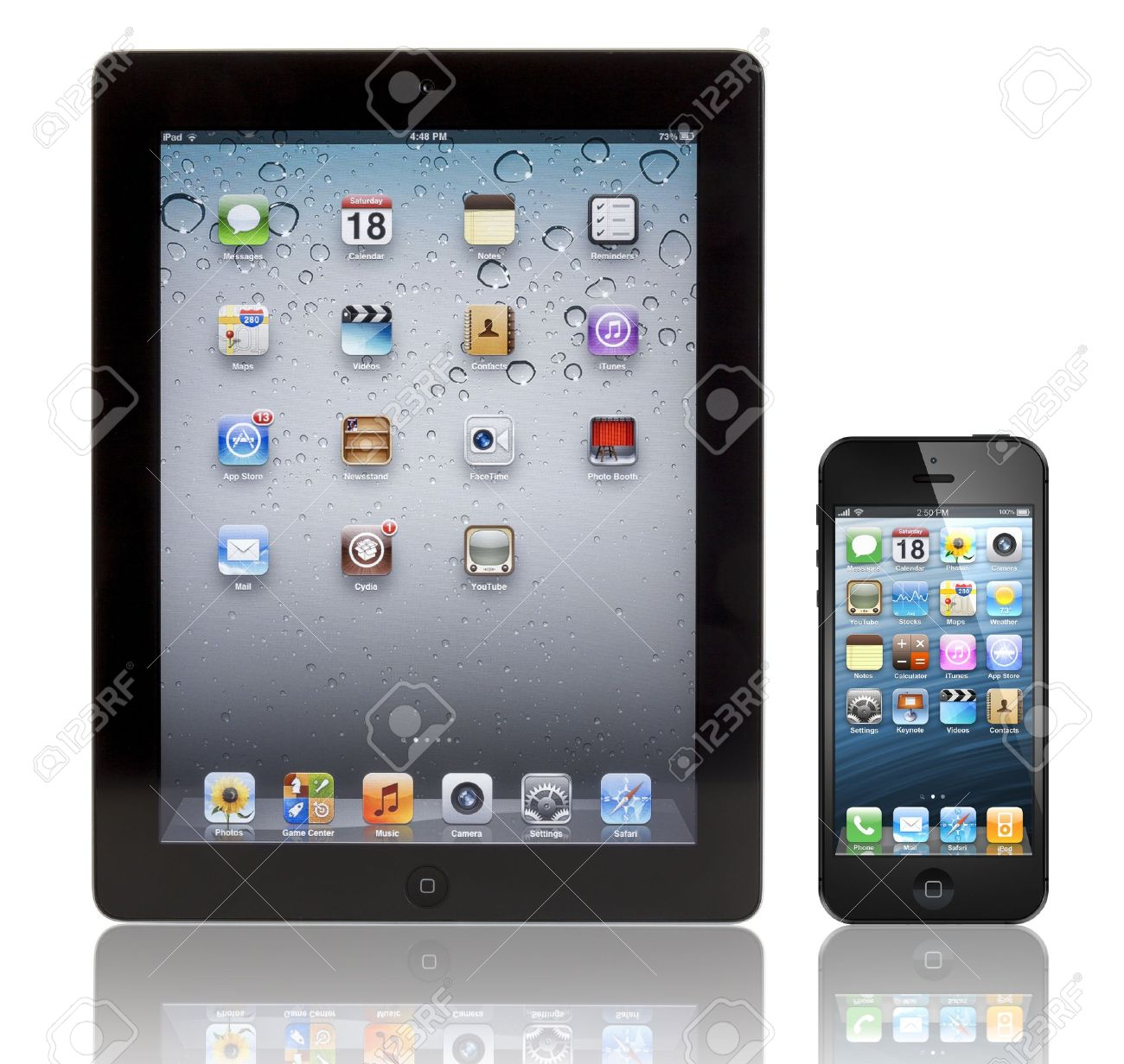 A Black Apple Iphone 5 In Front Of A Black Apple Ipad 3 Tablet