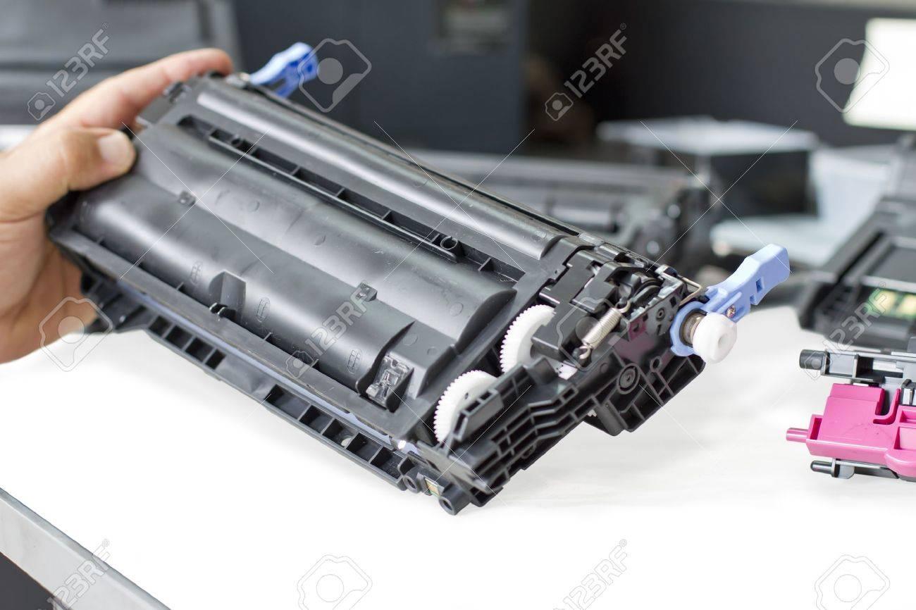 hand holding laser toner cartridge - 17499016