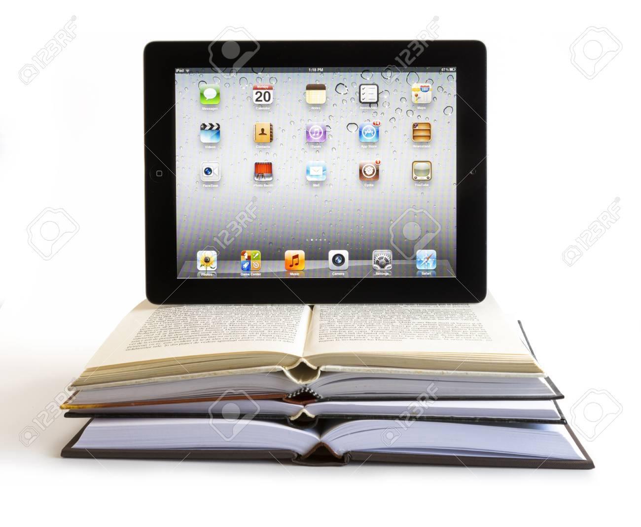 iPad 3 boasts a stunning retina display, a beefed up A5X dual-core processor, quad-core graphics. Studio shot on white background. - 18144565