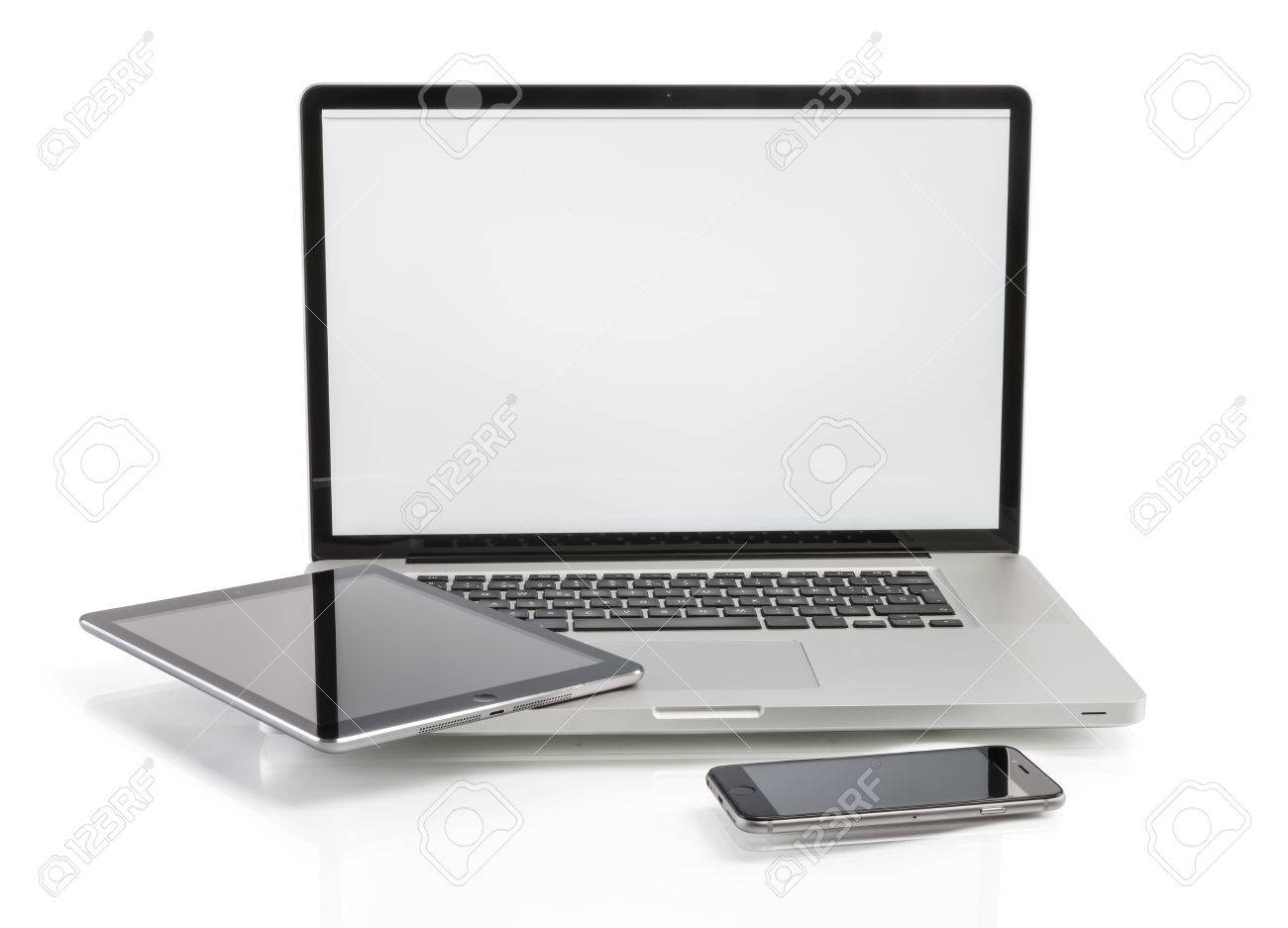 modern computer devices - laptop, tablet and phone with copy space on screen - 36293596