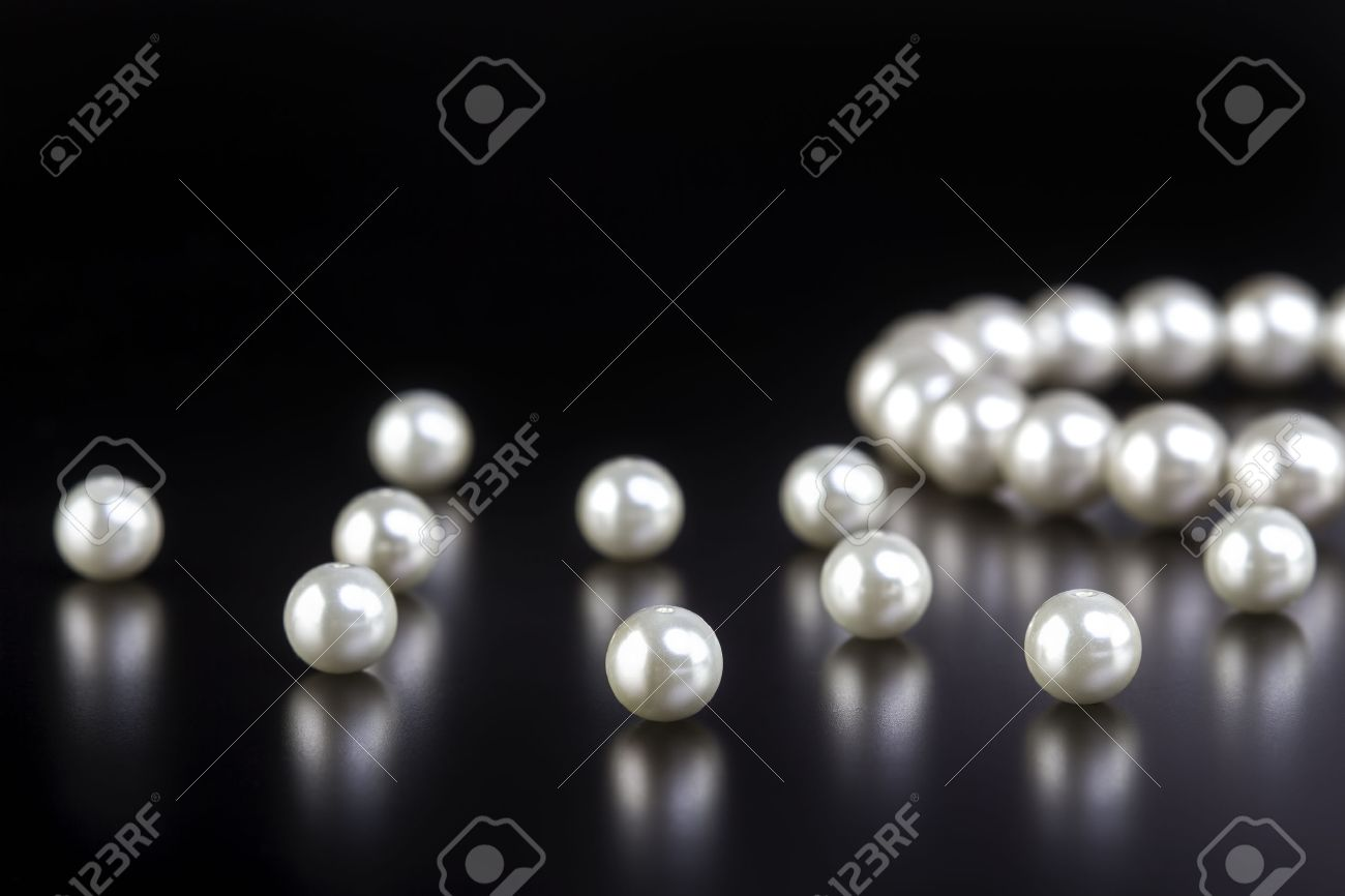 white pearls necklace on black background - 36293597