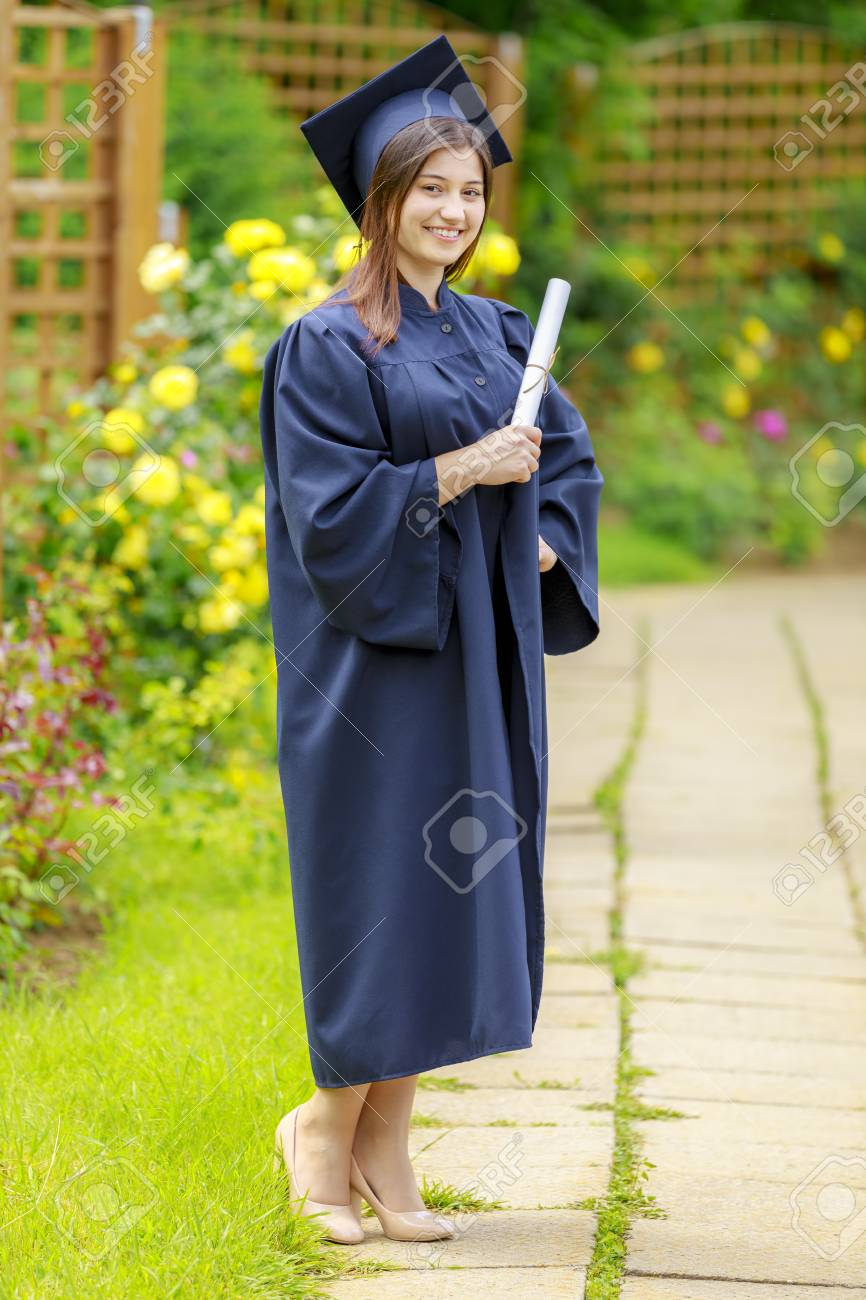 Smiling Young Woman Holding Diploma And Wearing Cap And Gown.. Stock ...