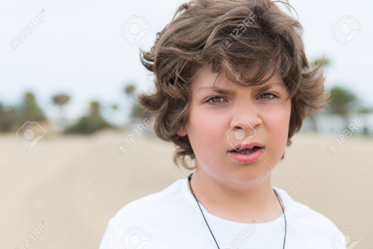 European School Age Boy With Green Eyes And Brown Hair Close Up