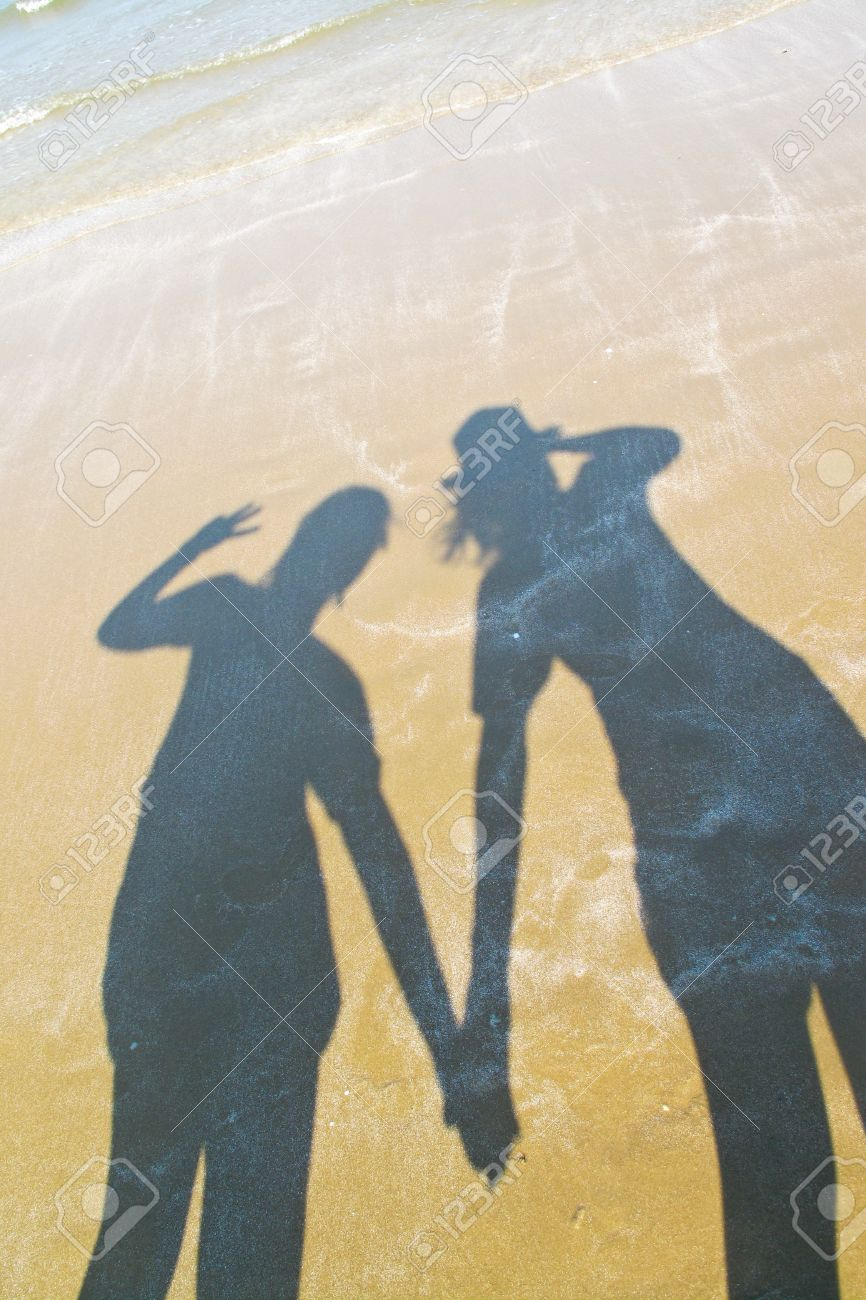 A shadow of two women holding hands together at the beach Stock Photo -  19110820 dfd26c9e12